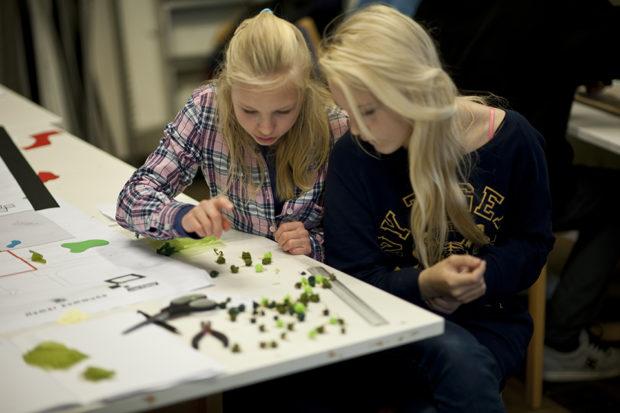 Young Norwegian girls building a model