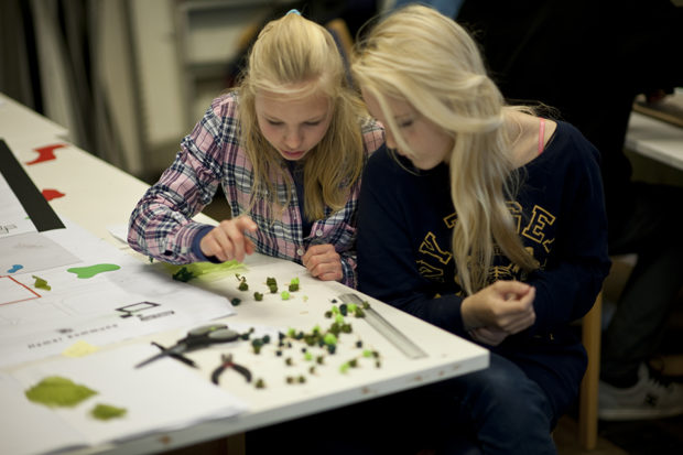 Young Norwegian girls building a model