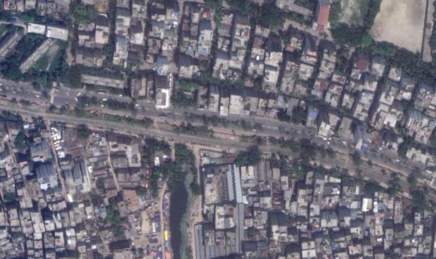 Desire lines crossing a street in Dhaka