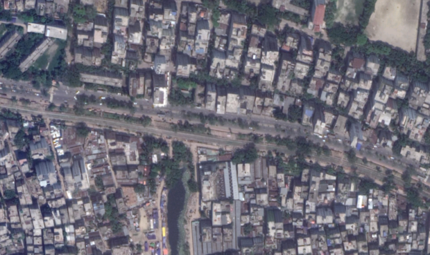 Desire lines crossing a street in Dhaka