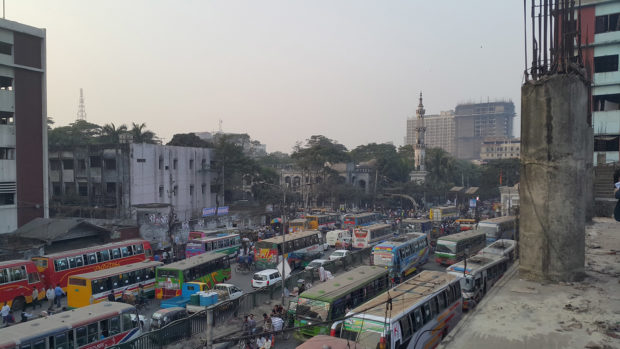 An overview of a busy avenue in Dhaka, from a five-story market under construction.
