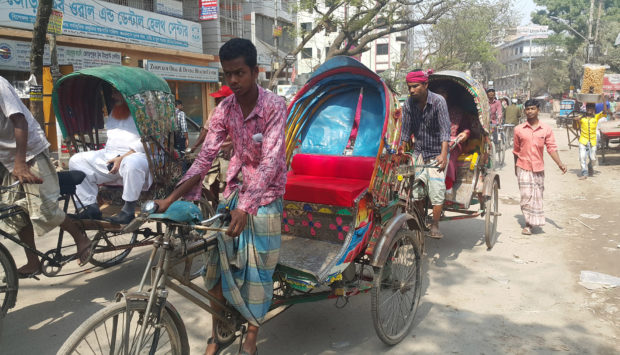 Rickshaws, the popular man-powered vehicles that constantly move and stop across the city