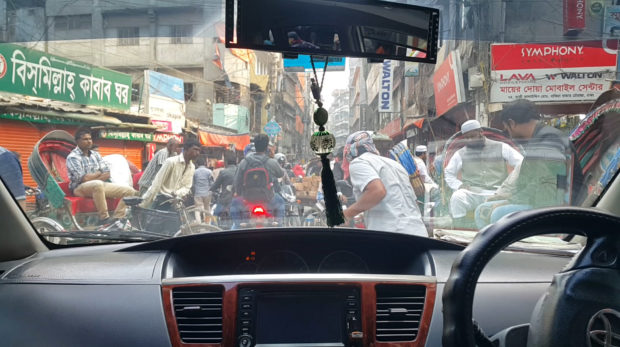 Trying to drive along a street in the Lalbagh area, in the city center of Dhaka.